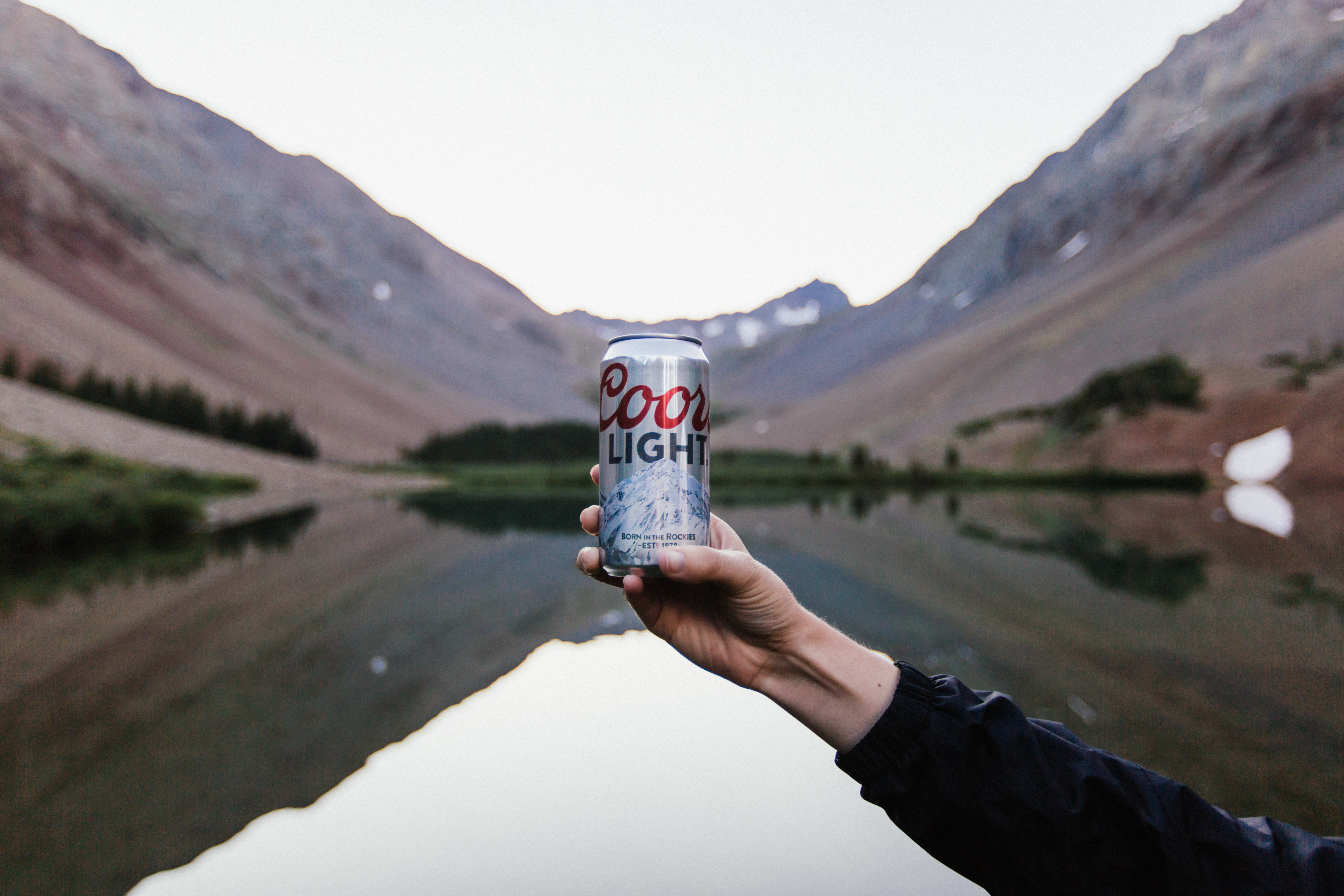 Mountain reflection with Coors.  Photo by Justin Kauffman